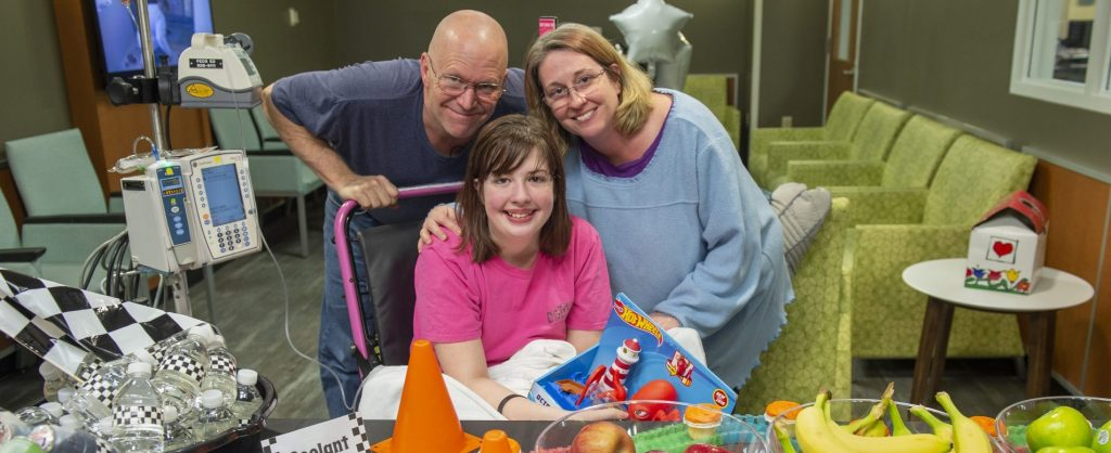 family together at hospital while their daughter receives treatment
