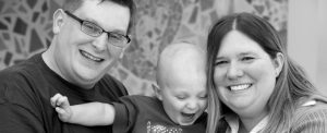 Family with sick child smiling