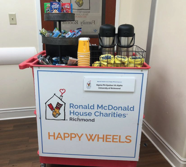 happy wheels cart filled with snacks and drinks for mcdonald's family room guests