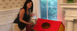 lady with collection of pop tabs placing in donation bin to benefit RMHC of richmond